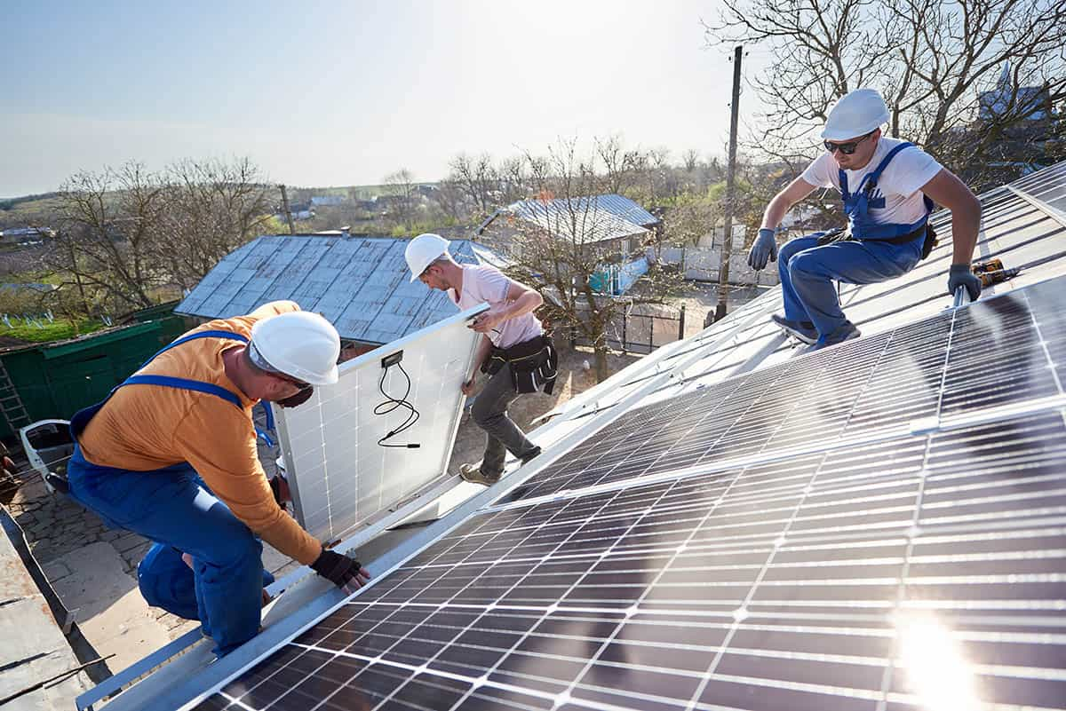 ehome by design solar installers on the roof installing a solar system